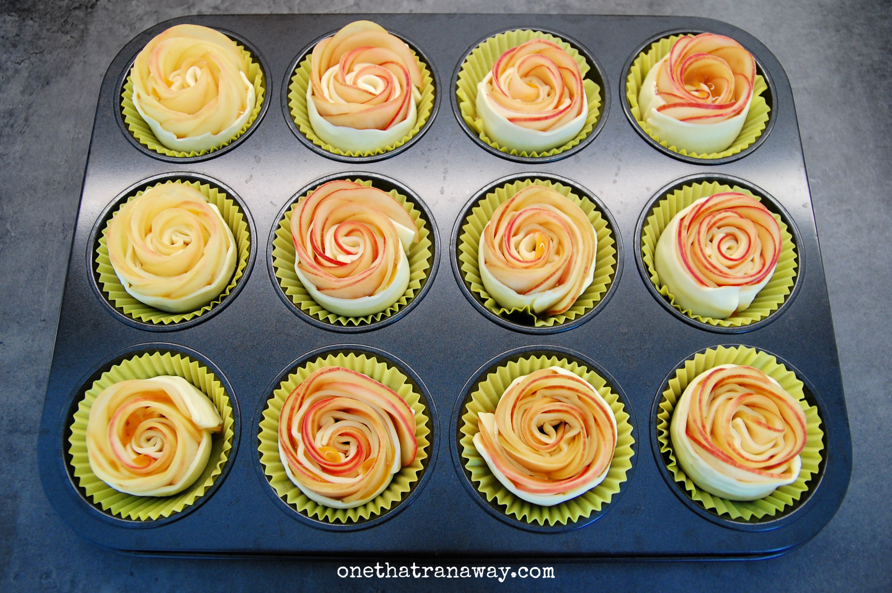 puff pastry apple roses in a muffin tray