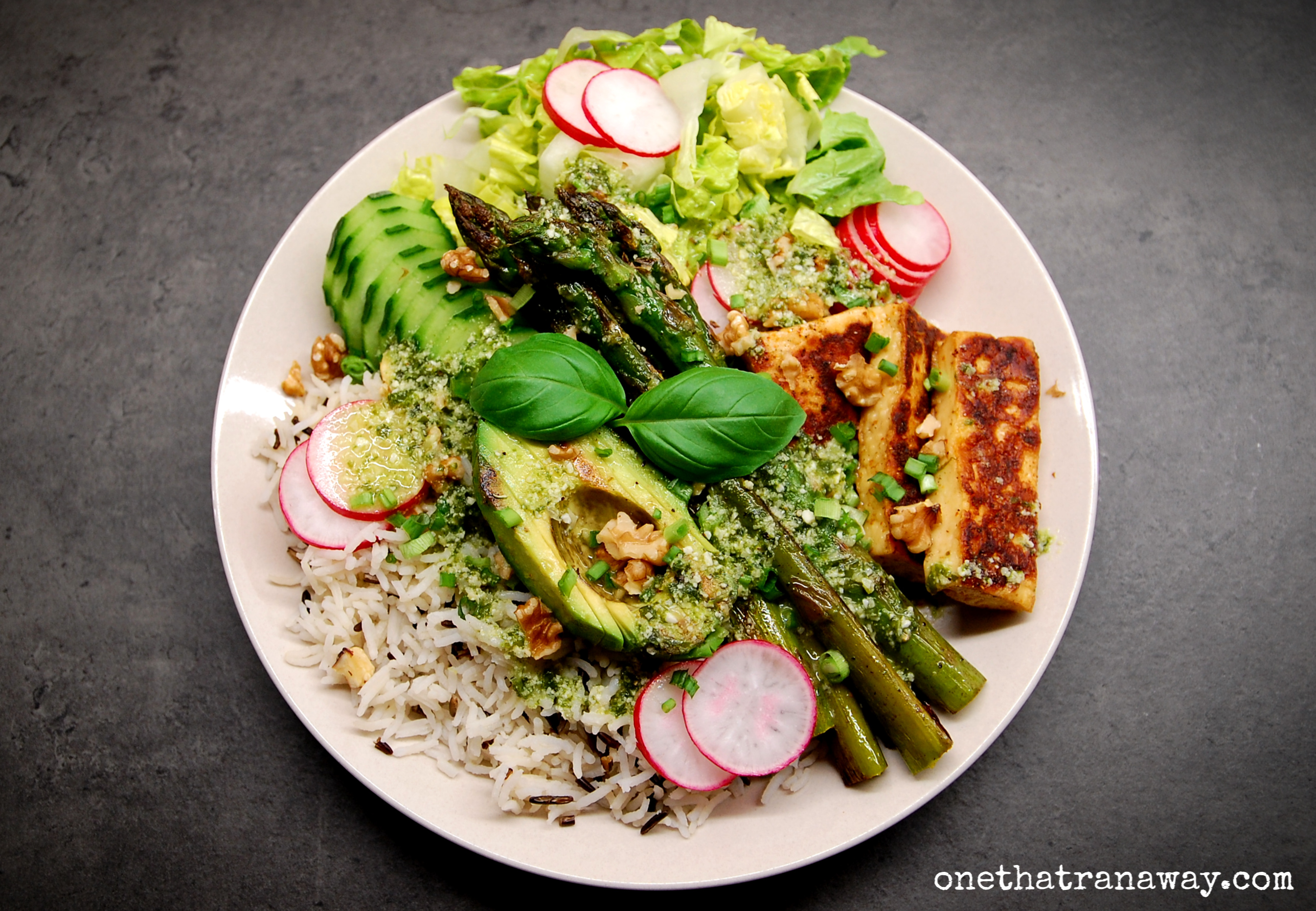 veggie packed spring bowl with asparagus, halloumi cheese and wild garlic dressing
