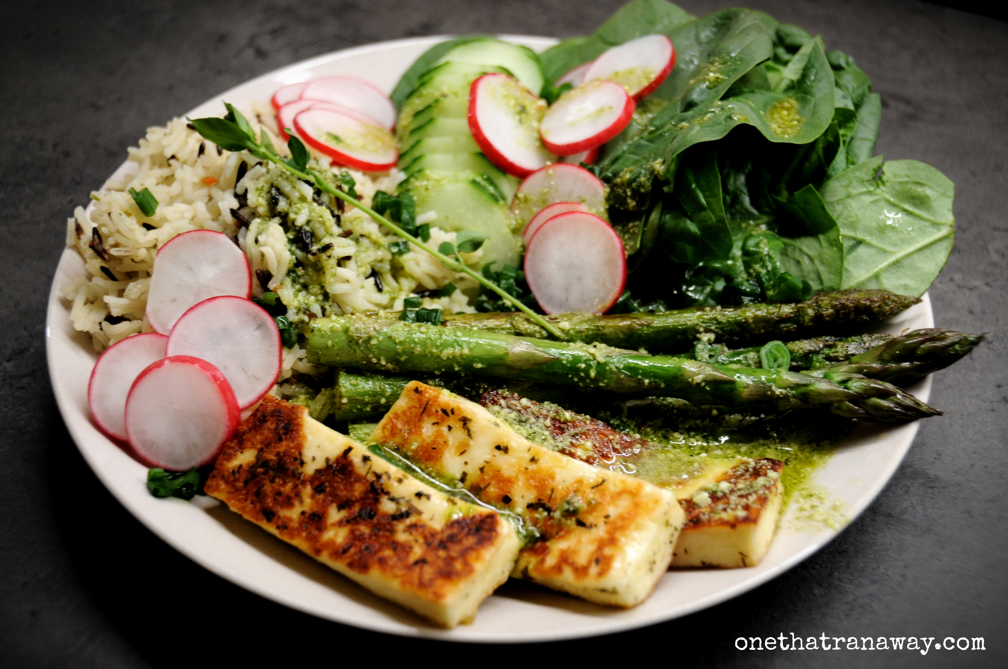healthy veggie packed spring bowl with asparagus and halloumi