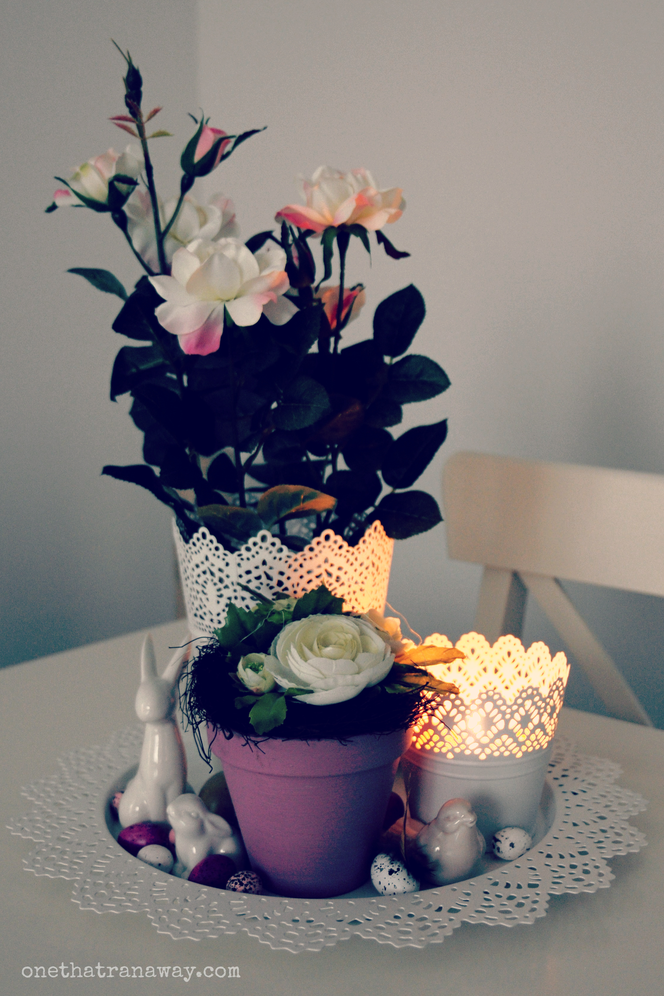 easter center piece with flowers and rabbit figurine