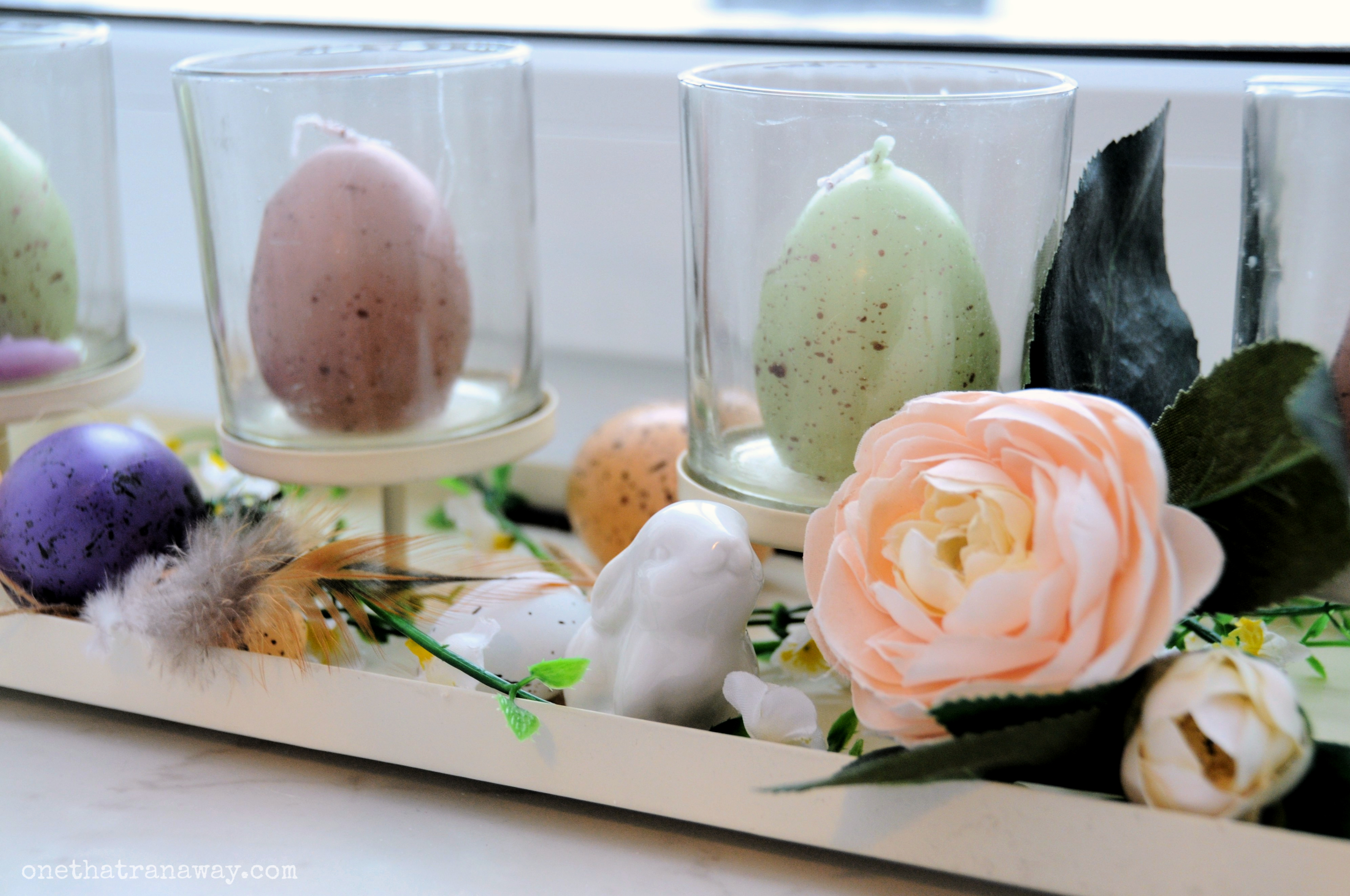 easter candles and flowers on a tray