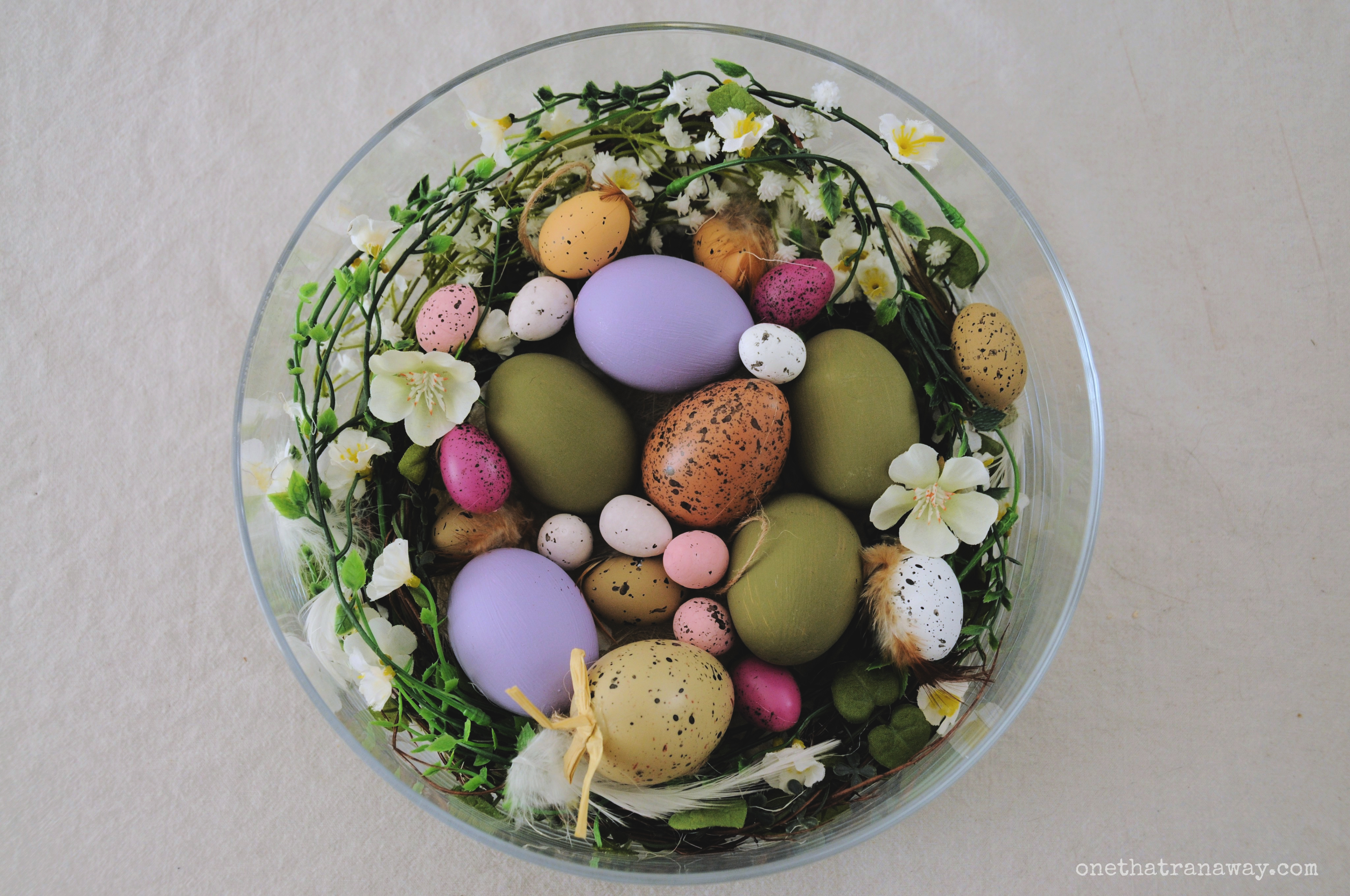 easter nest in a glass bowl with flowers