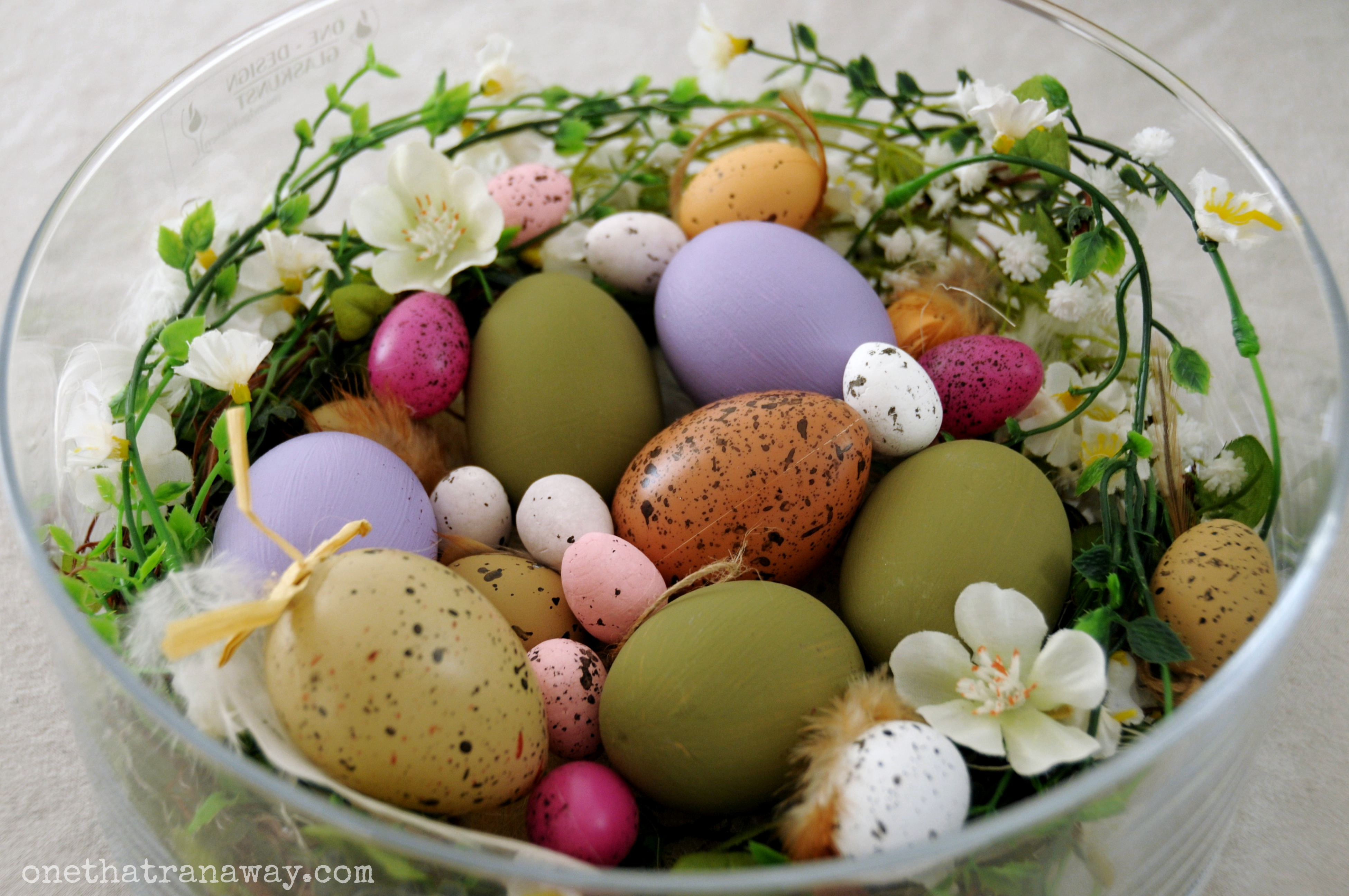 easter deacorations on a budget with an easter nest in a glass bowl