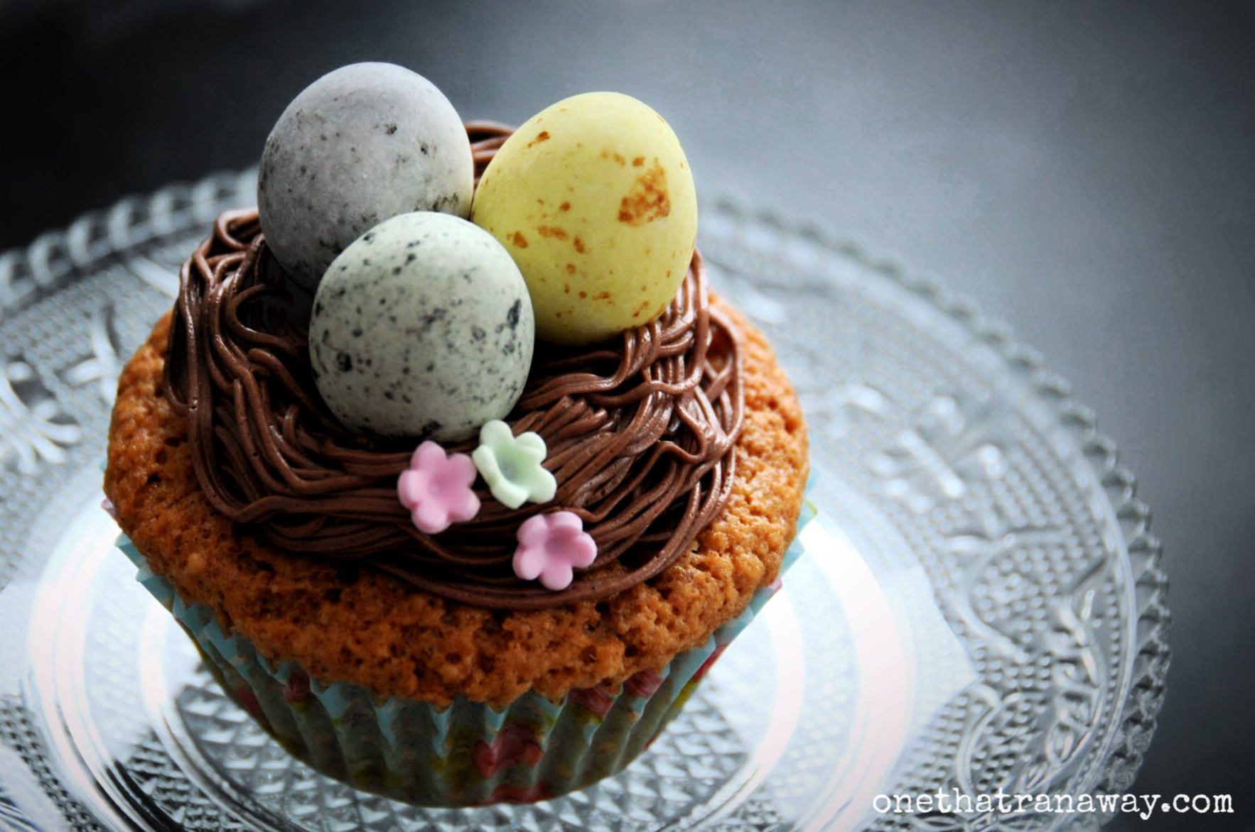easter nest cupcake on a glass plate